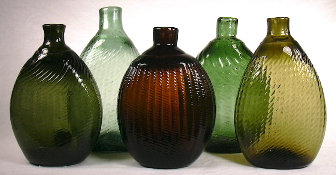 "Grouping of late 18th to early 19th century American ""Pitkin"" flasks."